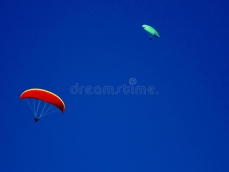 Paraglider flying with blue skies and moon stock images