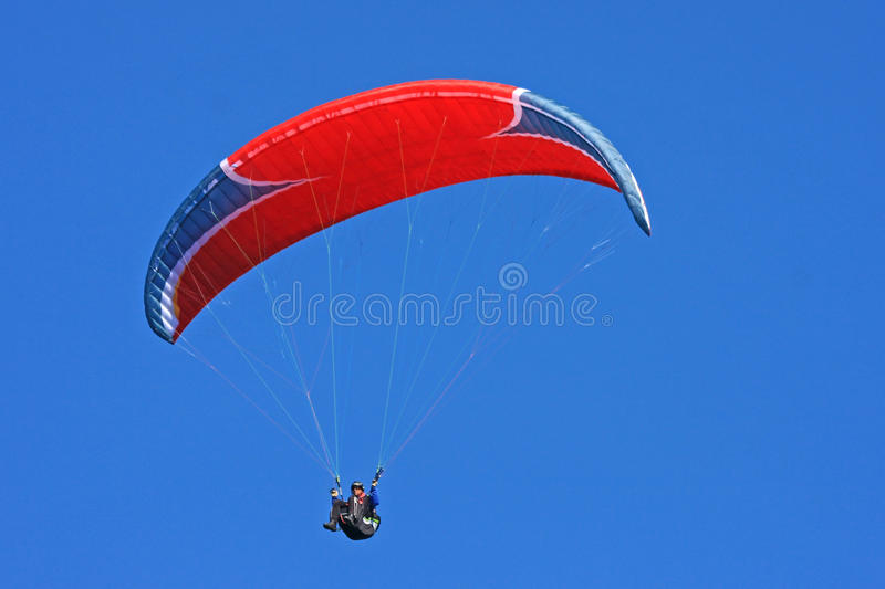 Paraglider. Flying in a blue sky stock images