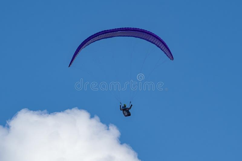 Paraglider flying in the clouds royalty free stock photos