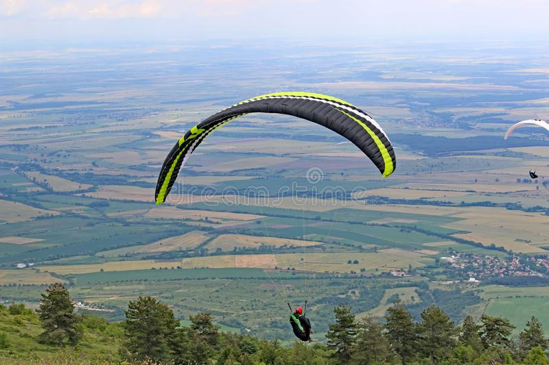 Paraglider flying from Dobrostan in Bulgaria stock images