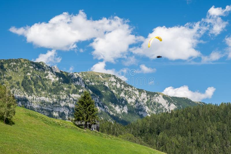 Paraglider flying in the mountains. Alpine landscape in Slovenia royalty free stock images