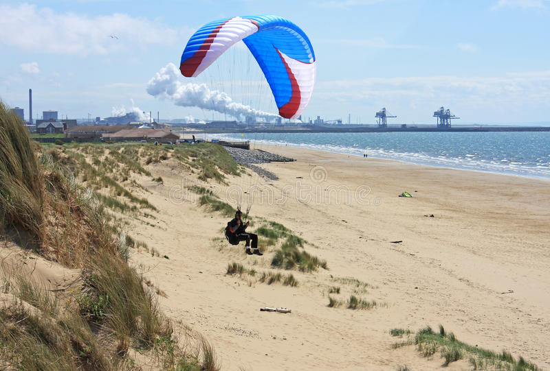 Paraglider. Flying over Aberavon beach royalty free stock images