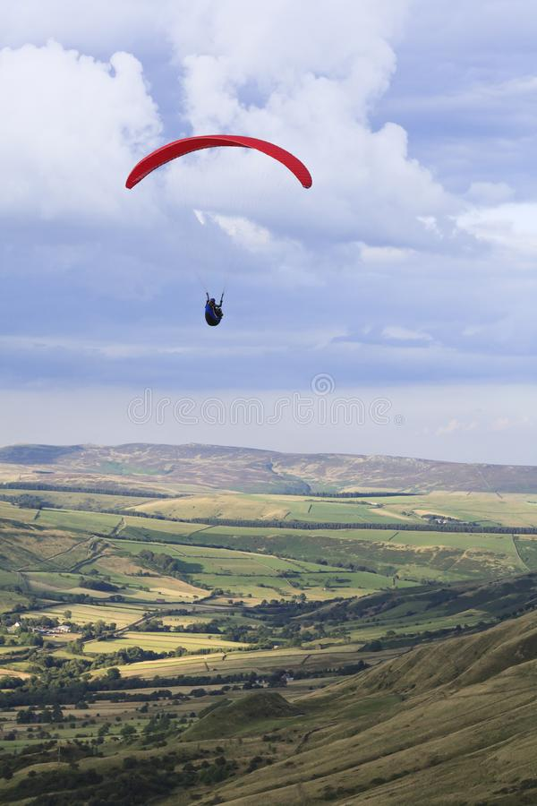Paraglider flying over English countryside royalty free stock photo