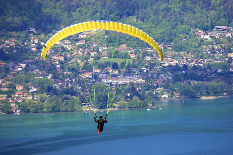 Paraglider. Flying over Lake Annecy royalty free stock photography