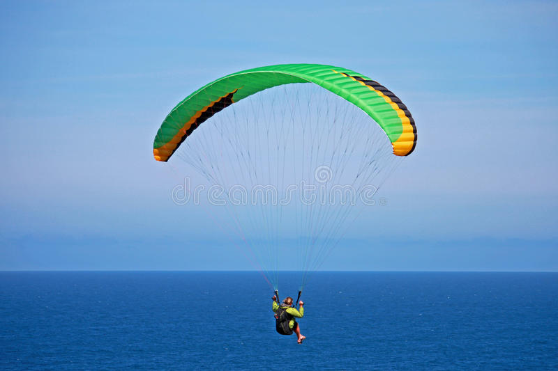 Paraglider. Flying over the sea royalty free stock photography