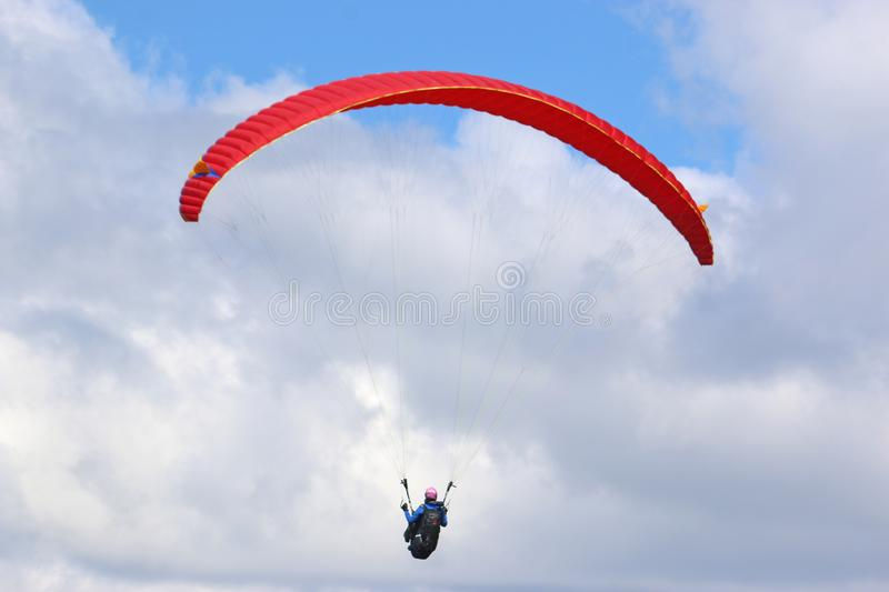 Paraglider flying stock photo
