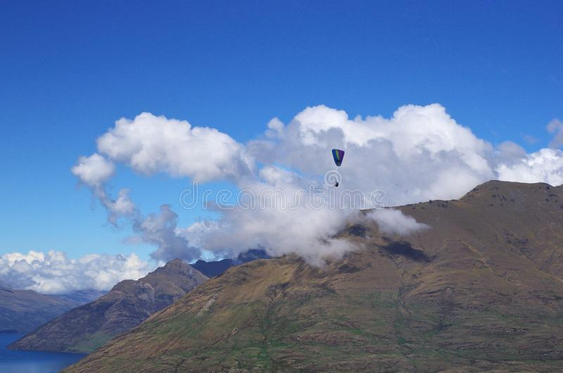 Paragliding in Queenstown, New Zealand. stock images