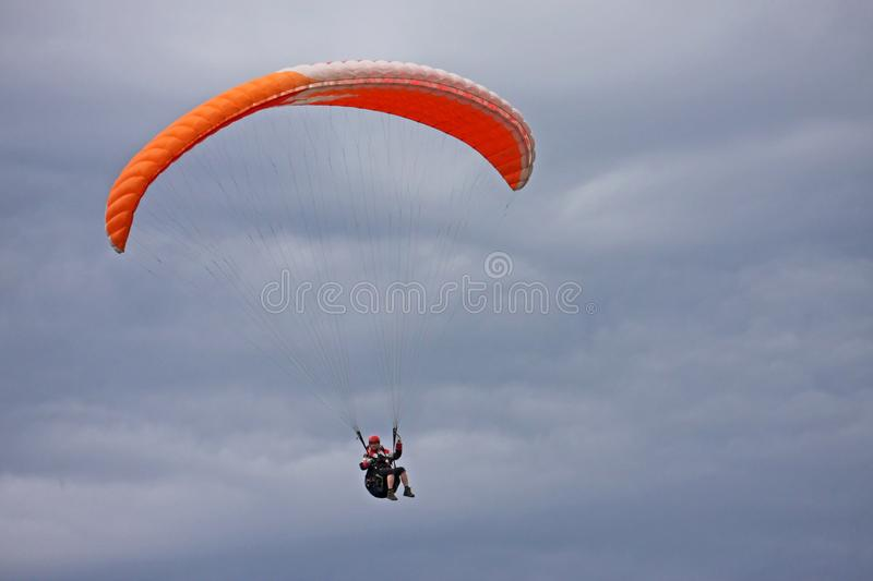 Paraglider flying wing in clouds royalty free stock images