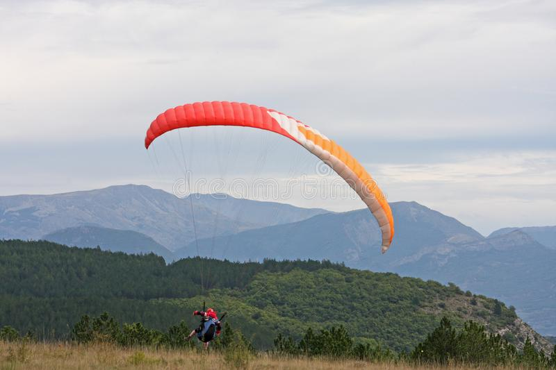 Paraglider landing stock photography