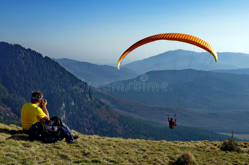 Paraglider over the Ciucas Mountains, landmark attraction in Romania. Paraglider over the Ciucas Mountains - landmark attraction in Romania stock photography