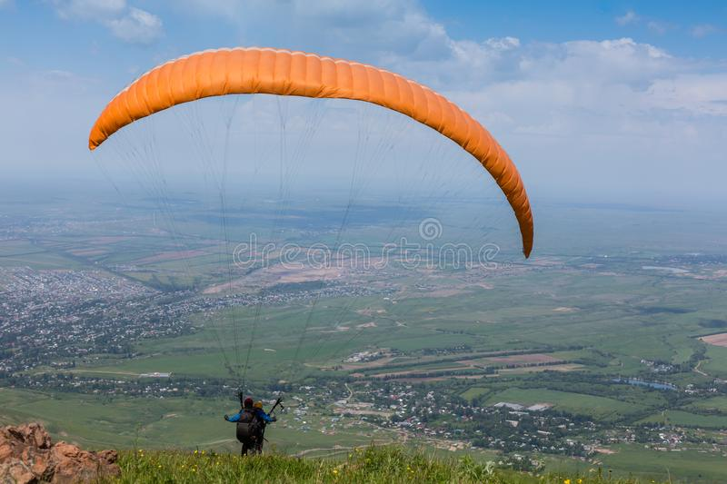 Paraglider is on the paraplane strops - soaring flight moment royalty free stock photo