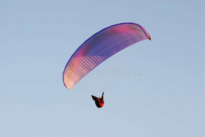 The paraglider pilot in the sky stock images