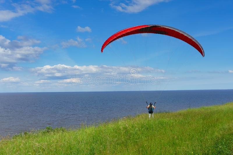 The paraglider. Is preparing to fly stock photography
