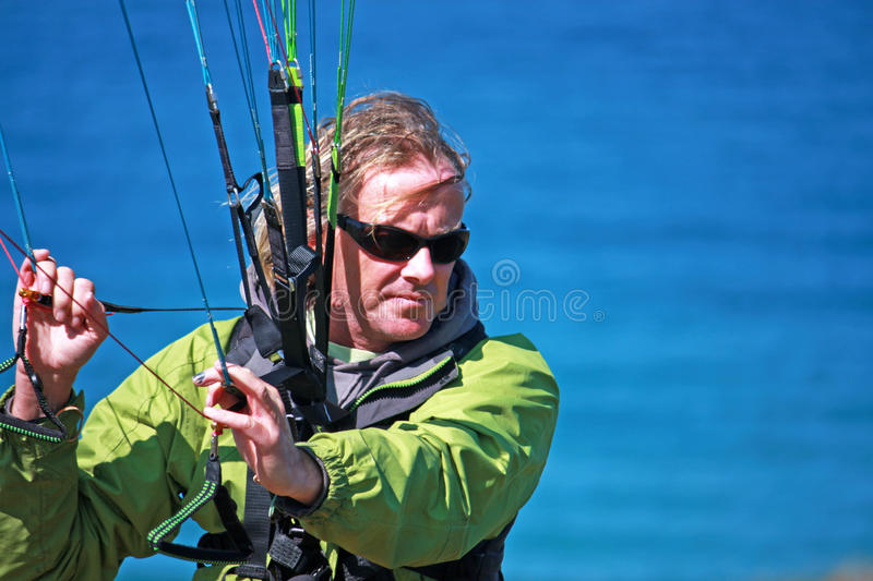Paraglider. Preparing to launch his wing stock photo