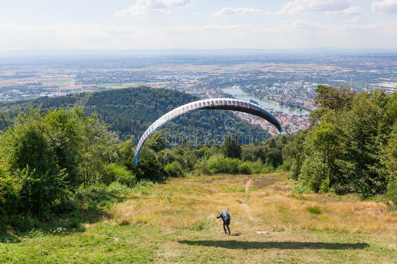 Paraglider running for take off stock images
