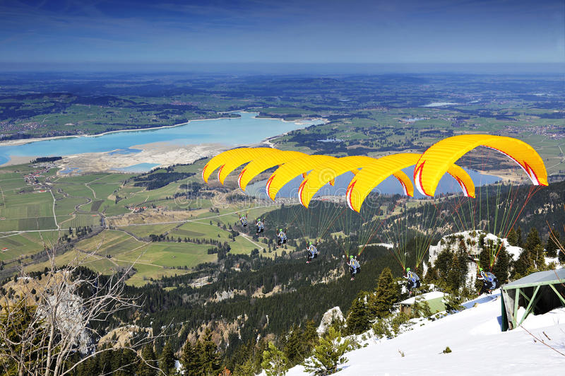 Paraglider sequence yellow in Bavaria royalty free stock photography