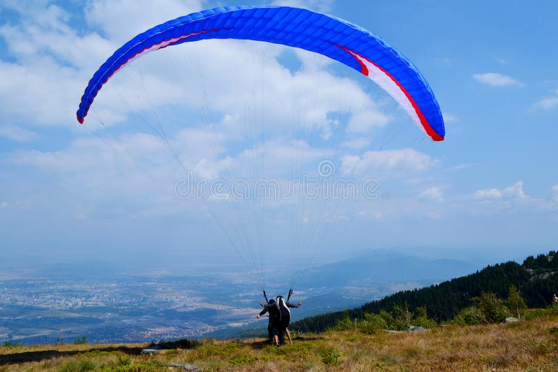 Paraglider in the Sky above the City stock image
