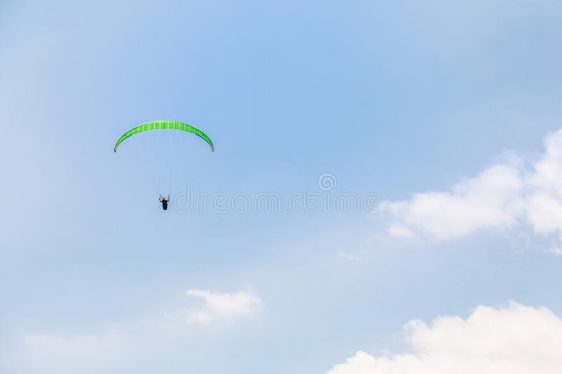 Paraglider soaring in the sky among clouds, Limassol royalty free stock images