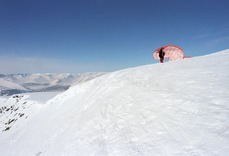 Download Paraglider starting stock image. Image of snow, blue, mountains - 1345969