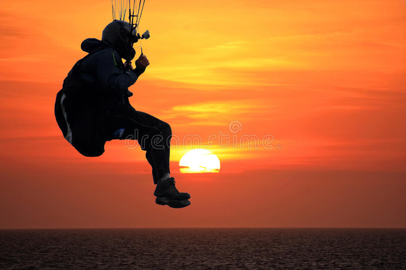 Paraglider at sunset. Paraglider over the sea at sunset stock photos