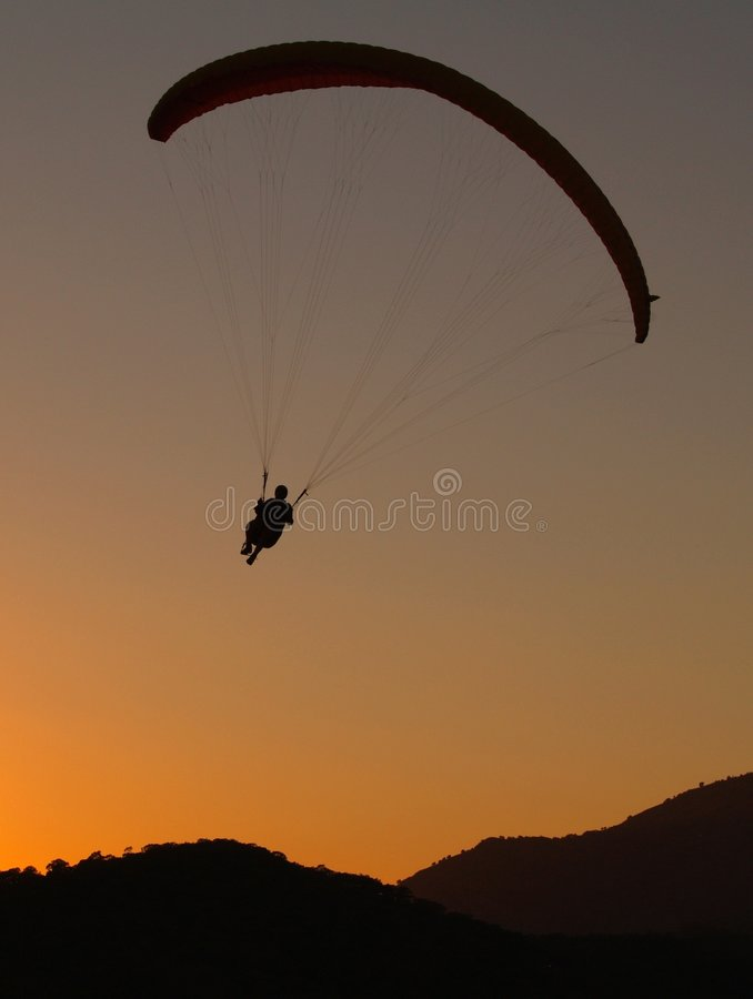 Paraglider at sunset stock image