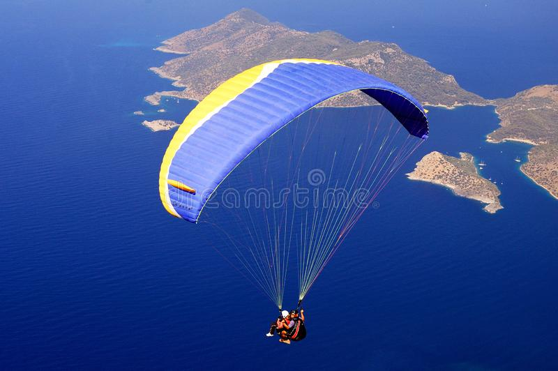 Paraglider tandem flying over the sea in Oludeniz, Turkey. stock photos