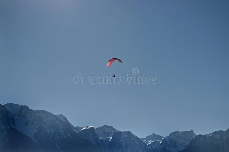 Paraglider tandem flying royalty free stock photo