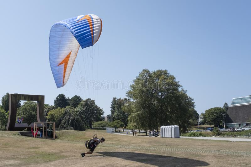Paraglider trying to take off stock image