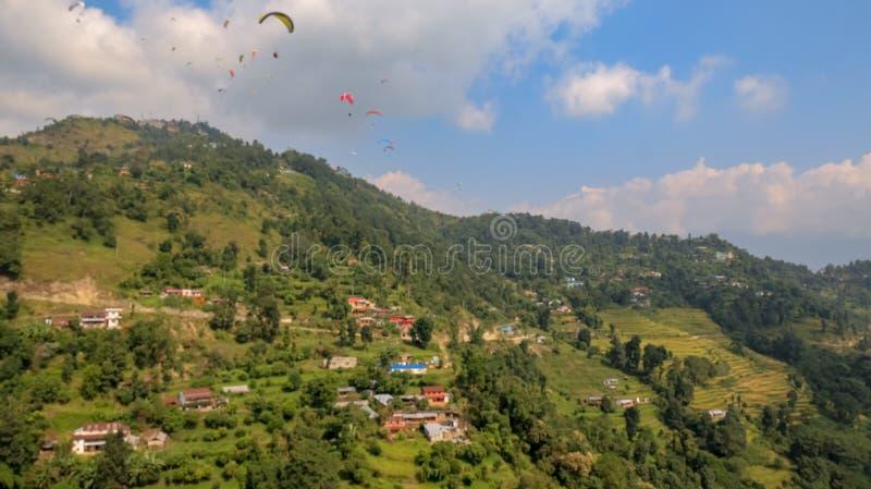 Paragliders flying over Sarangkot in Pokhara, Nepal royalty free stock photo