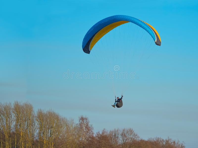 To fly on a paraglider, to be engaged in sports on a motor paraglider, paragliders are fond of flights. Paragliders are fond of flights, to fly on a paraglider royalty free stock photo