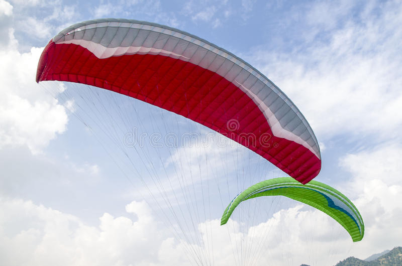 Paragliders. Para-gliders flying in the sky of Pokhara, Nepal royalty free stock photo