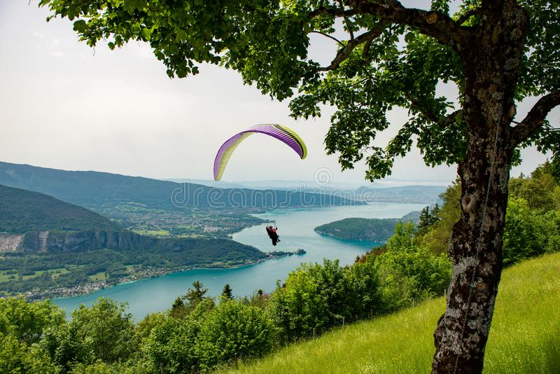 Paragliders with parapente jumping of Col de Forclaz near Annecy in French Alps, in France royalty free stock photo