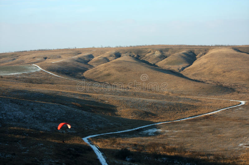 Paragliders. Russia, winter paragliding over the cold sea, extreme sports stock images
