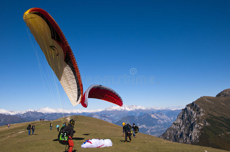 Paragliders at the top of Monte Baldo. Paragliding from the summit of Monte Baldo above Malcesine on the shores of Lake Garda in Northern Italy royalty free stock image