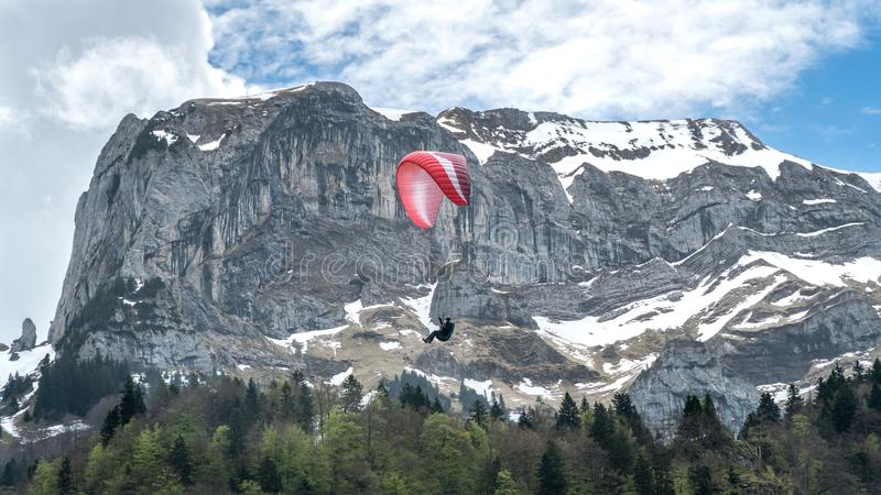 Paragliding in the Alps mountains, Switzerland stock images