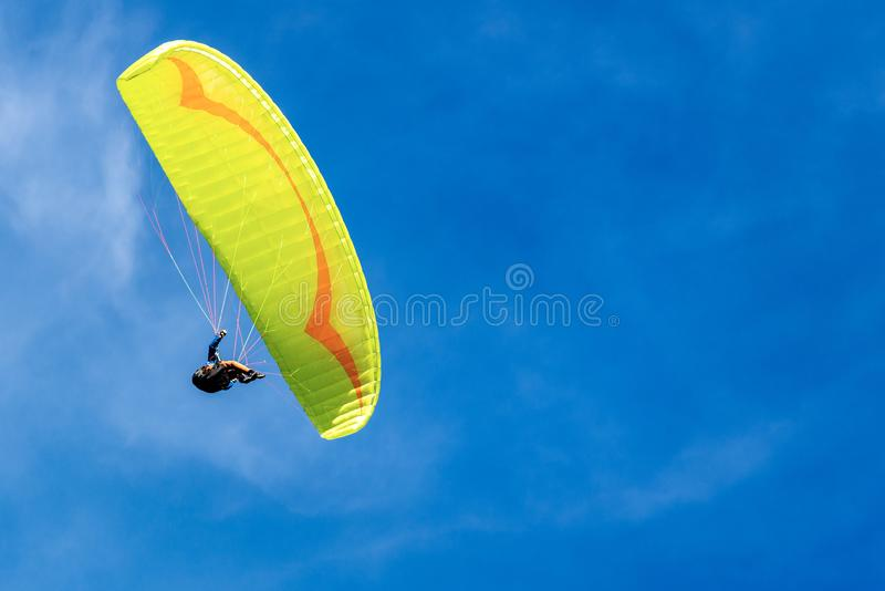 Paragliding on a Blue sky with Clouds royalty free stock photos