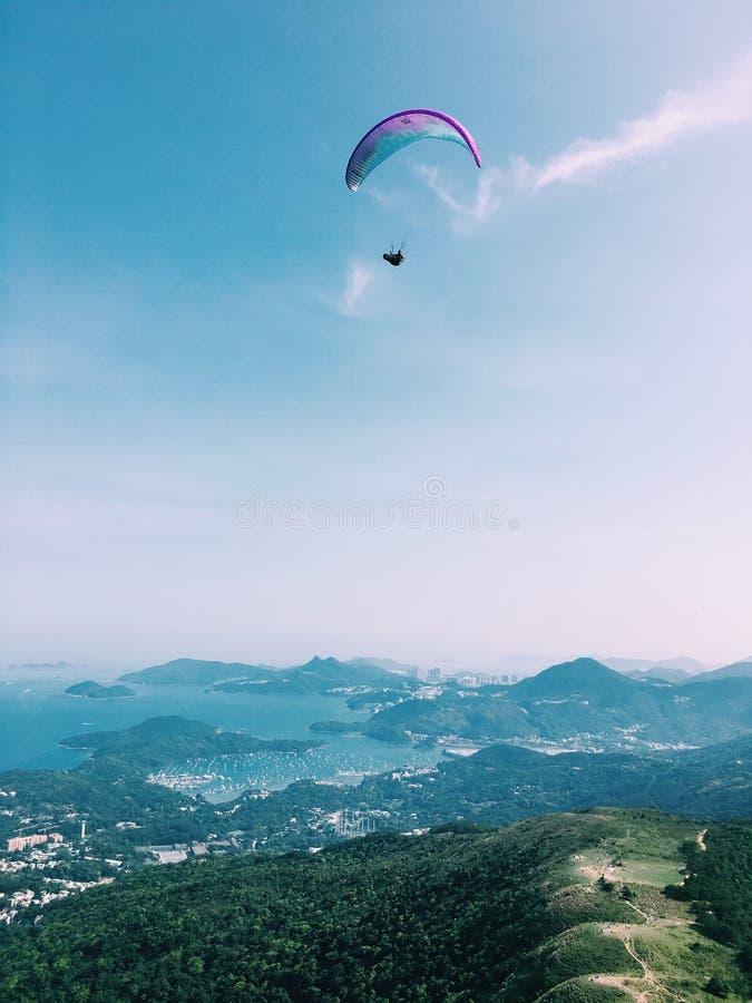 Paragliding blue sky royalty free stock photo