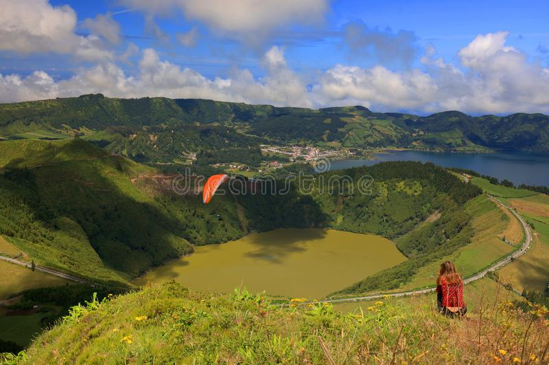 Paragliding on the cloudy sky, Sete Cidades, 30 July 2017. Paragliding over Sete Cidades, Sao Miguel Island, Azores, Portugal, Europe royalty free stock photo