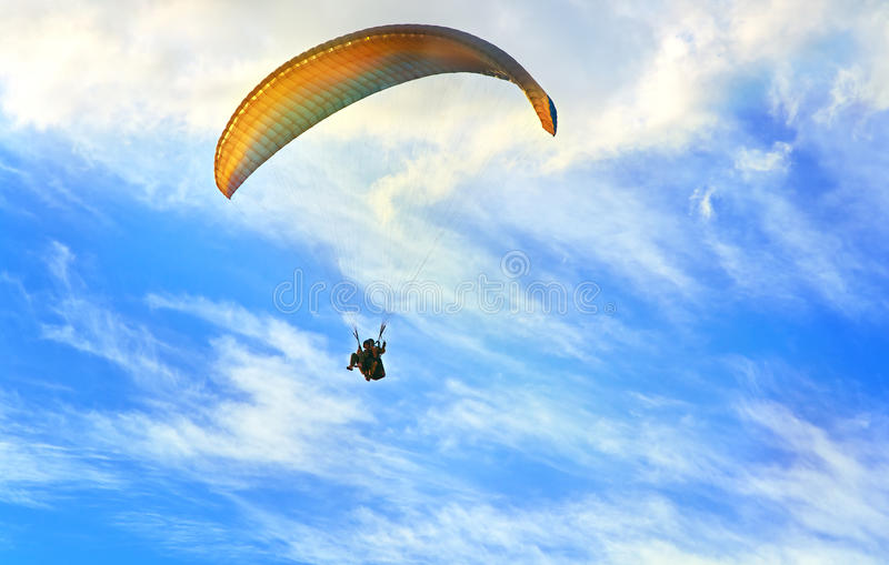 Paragliding extreme Sport with blue Sky and clouds on background royalty free stock photos