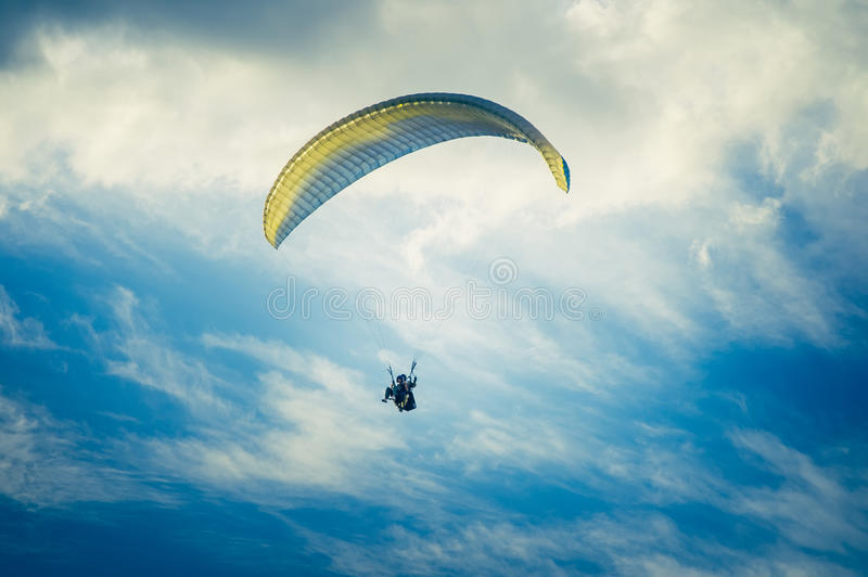 Paragliding extreme Sport with blue Sky and clouds royalty free stock images
