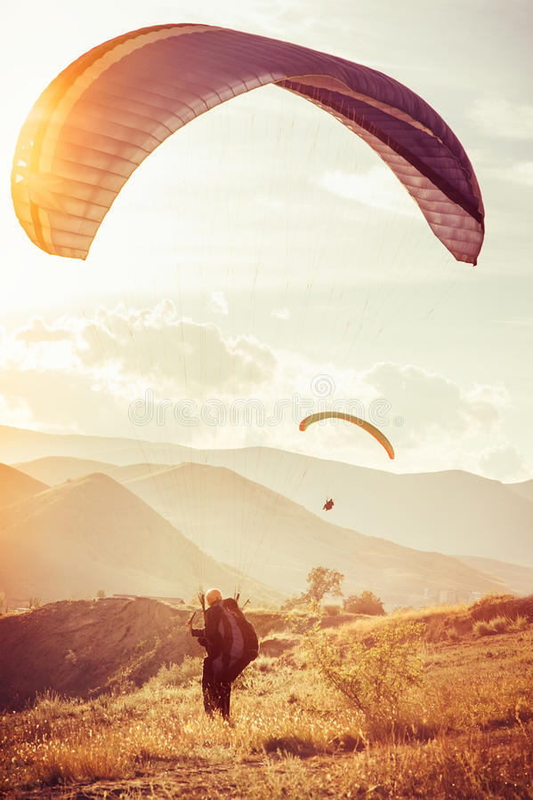 Paragliding extreme Sport. With mountains on background Healthy Lifestyle and Freedom concept Summer Vacations stock image