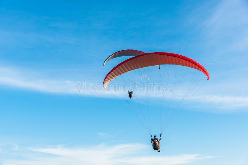 Paragliding Extreme sport, Paraglider flying on the blue sky and white cloud in Summer day at Phuket Sea, Thailand stock images