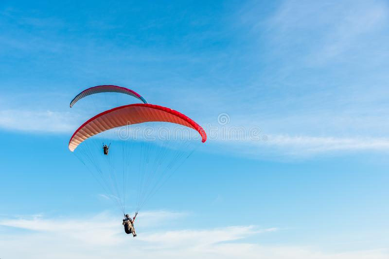 Paragliding Extreme sport, Paraglider flying on the blue sky and white cloud in Summer day at Phuket Sea, Thailand royalty free stock photos
