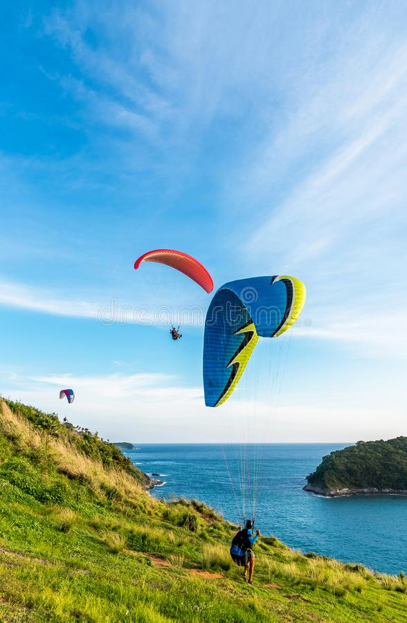 Paragliding Extreme sport, Paraglider flying on the blue sky and white cloud in Summer day at Phuket Sea, Thailand royalty free stock images