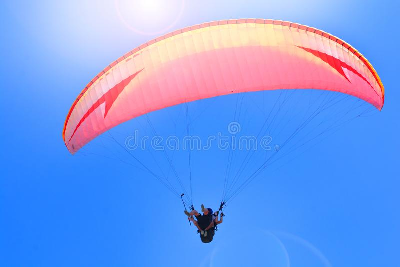 Paragliding extreme sport. Paragliders together flying on a sky background royalty free stock images