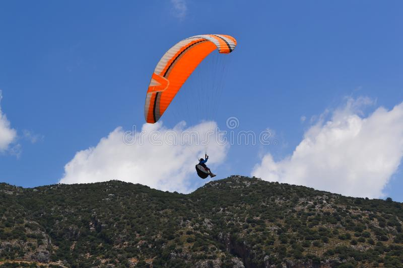 Paragliding extreme sport. Paragliders together flying on a sky background stock photo