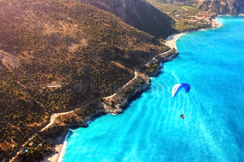 Paragliding flight over the sea coast of the Mediterranean Sea. Blue parachute against the blue sea. Turkey. Oludeniz. Aerial phot. Ography. Travel and sport royalty free stock photo