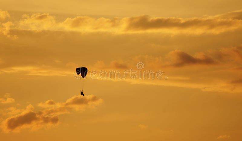 Paragliding is flying across the evening sky royalty free stock photos