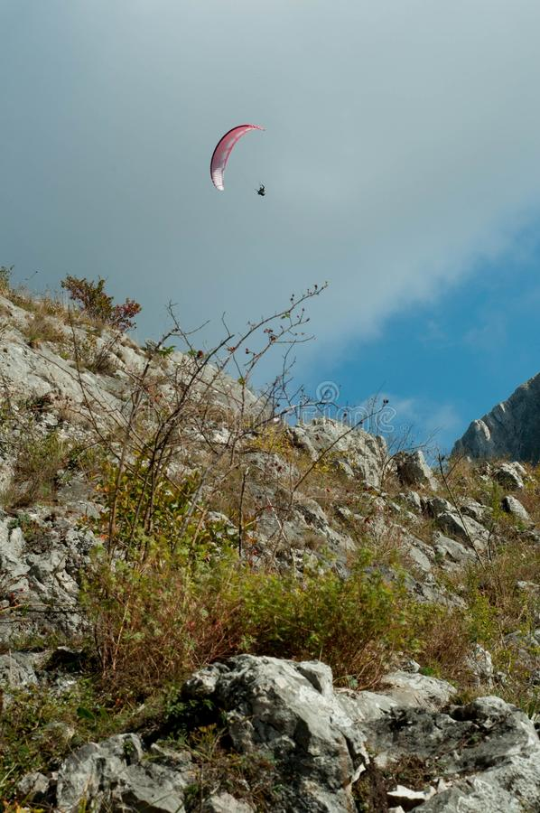 Paragliding in the mountains. Adrenaline on a sunny day in the mountains stock photography