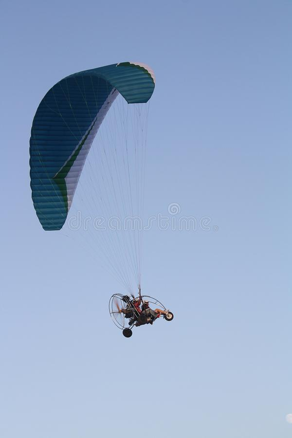 Paragliding over blue sky stock photo. Image of road ...